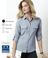 Inspect a sample of the Madison Blouse #S626LL. The Madison is a versatile workplace uniform blouse available in Midnight Blue, Silver Mist, Blush Pink, Ivory. Wear it sleeves down and tucked in for a streamlined look or roll up the sleeves and wear loosely out for a contemporary cool style. Available Long, Short and Sleeveless.  Fuss free fabric with a litte STRETCH so you will be comfortable all day long. Sizes 6-26. For all the details on Staff Uniforms please call Renee Kinnear or Shelley Morris on FreeCall 1800 654 990