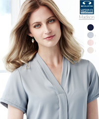 The Madison Blouse #S628LS Shorts Sleeve is a versatile workplace uniform blouse available in Midnight Blue, Silver Mist, Blush Pink, Ivory. Has a concealed button placket, a built in action back pleat and functional easy care fabric.  Fuss free fabric with a litte STRETCH so you will be comfortable all day long. Sizes 6-26. For all the details on Staff Uniforms please call Renee Kinnear or Shelley Morris on FreeCall 1800 654 990